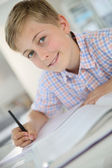 Boy sitting in classroom — Stock Photo