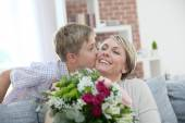 Boy giving flowers to mommy — Stock Photo