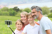 Family taking selfie picture — Stock Photo