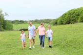 Family walking on country trail — Stock Photo