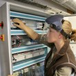 Oman checking electrical system — Stock Photo #79359948