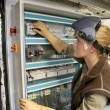 Oman checking electrical system — Stock Photo #79359958