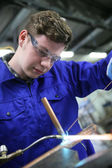 Student  working on copper — Stock Photo