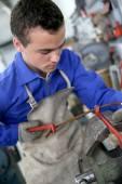Man training working on steel — Stock Photo