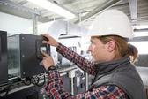 Technician controlling equipment — Stock Photo