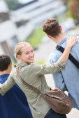 Girl walking with school mates — Stock Photo