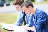 People sitting in park to study — Stock Photo