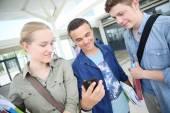 Students using smartphone — Stock Photo