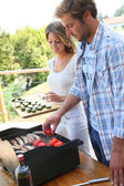 Couple preparing bar-b-q meat — Stock Photo
