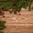 Christmas fir tree on a wooden board — Stock Photo #59721827