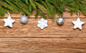 Decorated Christmas fir tree on a wooden board — Foto Stock