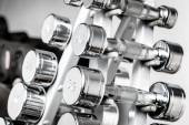 A rack with metal dumbbells. — Stock Photo