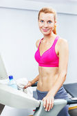 Young woman doing cardio on treadmill in a gym. — Stock Photo