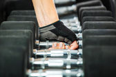 A rack with metal dumbbells in gym. — Stock Photo