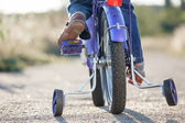 Kids bike with training wheels closeup — Stock Photo