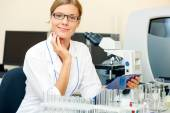 Portrait of beautiful young woman in a laboratory. — Stock Photo