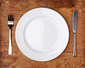 Knife, Fork and plate on wooden table.  — Photo