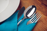 Knife, Fork, Spoon and plate on wooden table. — Photo