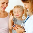 Doctor taking blood test from small patient. — Stock Photo #57884361
