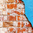 Old red bricks and blue stucco background. — Stock Photo #58408129