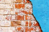 Old red bricks and blue stucco background. — Photo