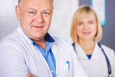 Portrait of two happy mature doctors. — Stock Photo