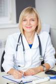 Portrait of confident doctor looking at camera. — Stock Photo