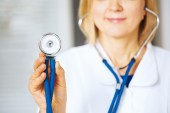 Closeup of hand holding stethoscope. — Stock Photo