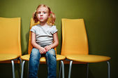 Little redhead girl waiting in reception room. — Stock Photo