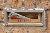 Old letter slot with newspaper closeup. — Stock Photo