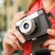 Woman photographer with old lomo camera. — Stock Photo #68104973