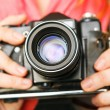 Woman photographer holding old 35mm film camera. — Stock Photo #68104983