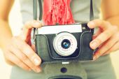Woman photographer with old lomo camera. — Stock Photo
