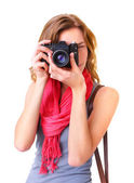 Young redhead woman looking through viewfinder with an old 35mm  — Stock Photo