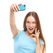 Beautiful young woman taking a picture of herself with her camer — Stock Photo