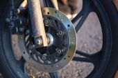 Closeup of motobike front wheel. — Stock Photo