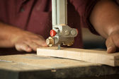 Professional carpenter working with sawing machine in workshop. — Stock Photo