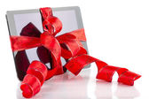 Tablet pc with Christmas red ribbon — Stockfoto