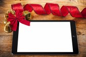Tablet pc with christmas decorations on wood — Stock Photo