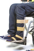 Orthopedic equipment for young man in wheelchair - close up — Stock Photo