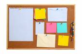 Blank notes pinned into brown corkboard — Stock Photo