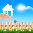 The house in hand on green natural background. Vector. — Stock Vector #53490771