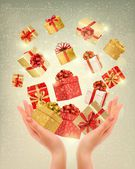 Christmas gold background with gift boxes and hands. Vector illu — Stock Vector