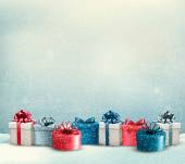 Holiday Christmas background with a border of gift boxes. Vector — Vector de stock