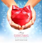 Holiday christmas background with hands holding gift box. Concep — Stockvektor