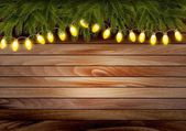Christmas wooden background with branches and a garland. Vector  — Stock Vector