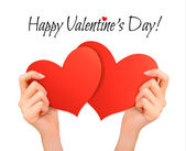 Holiday valentine background with hands holding two red hearts.  — Stock Vector