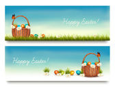 Two Happy Easter banners with easter eggs in a basket. Vector. — Stok Vektör