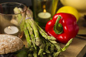 Fresh green asparagus spears with red bell pepper — Stock Photo