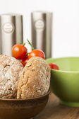 Freshly baked brown wholegrain bread rolls — Stock Photo